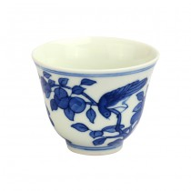 blue and white flower grain kiln cup